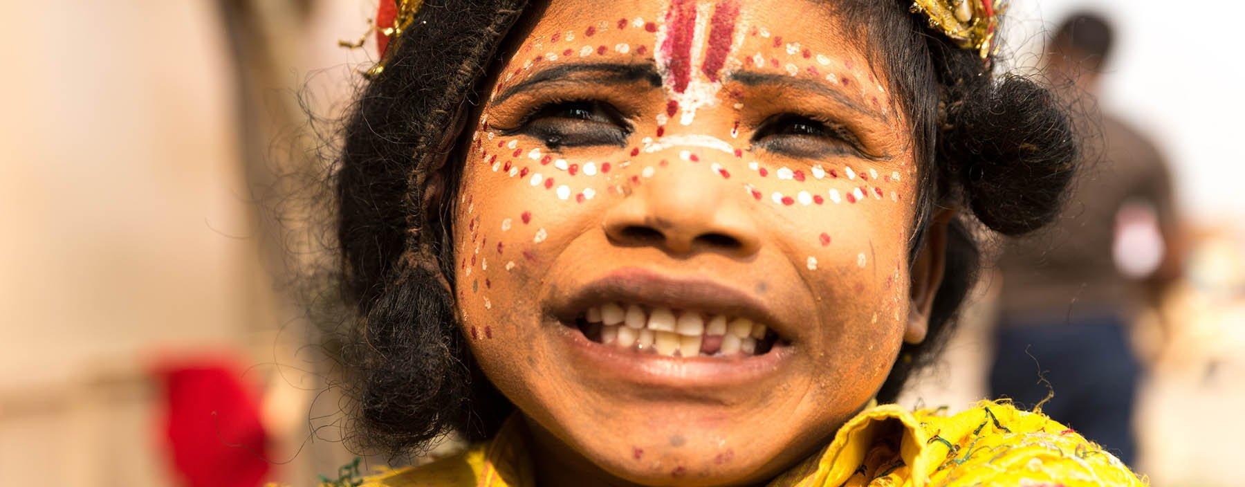 in, varanasi, children painted near raj ghat.jpg